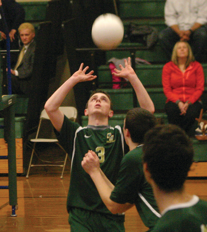 MATT MEDEIROS sets the ball.