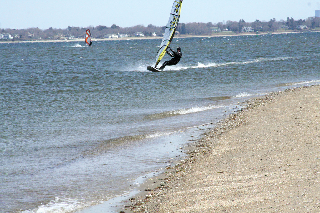 SPEEDING: Traveling at close to 30 mph, windsurfer Ted Howell flies just offshore at Conimicut Point.