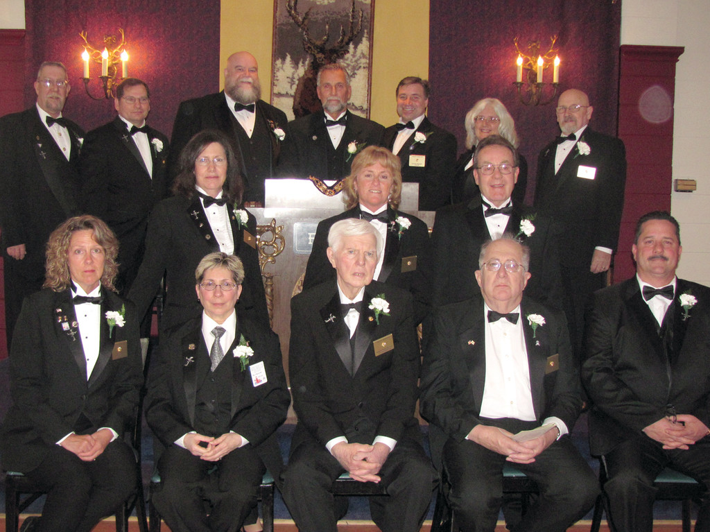 ELKS LEADERS: These are the 14 people, headed by Exalter Ruler Mark Eaton of Warwick, who were duly installed Sunday as the new officers of Tri-City Elks Lodge No. 14, located at 1915 West Shore Road. The group includes: Charles Greaves, James Suttles Jr., Steve Lagesse, Carol Delory, Lori Eaton, David Knight, Anne Marie Greaves, Timothy Beaudry, Dick Warner, Gerald Lapierre, John Collins, Cheryl Devlin and Donna Warner, PER.