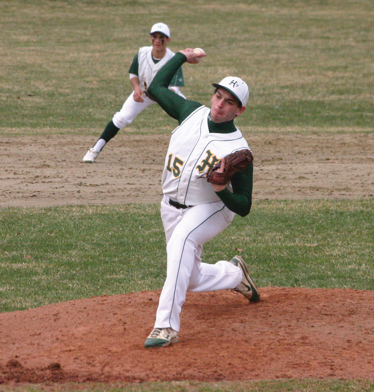 DELIVERY: Hendricken's Dillon Manfredi makes a pitch in Thursday's 9-0 win over Cranston West. It was West's second straight lopsided victory to open the year.