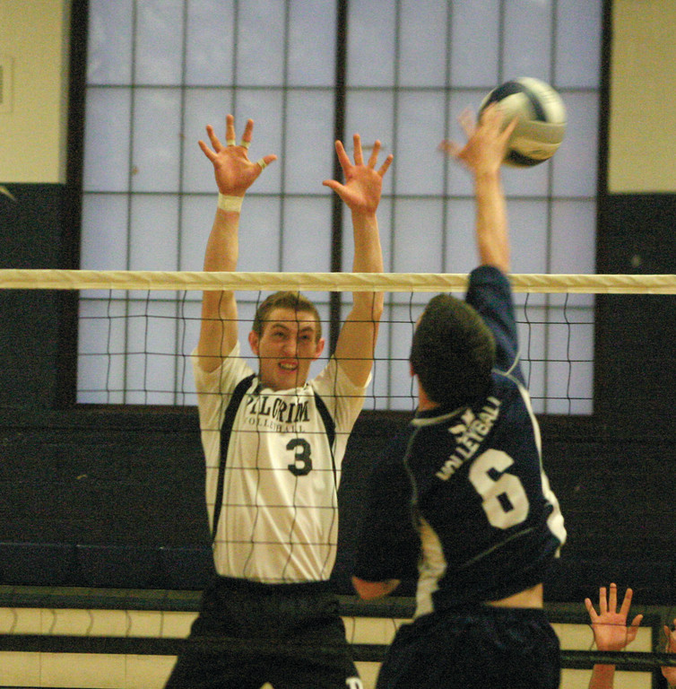 BLOCK PARTY: Pilgrim's Caleb Fournier rises for a block at the net in Friday's match with South Kingstown. The defending state champ Rebels kept the Pats out of the win column.