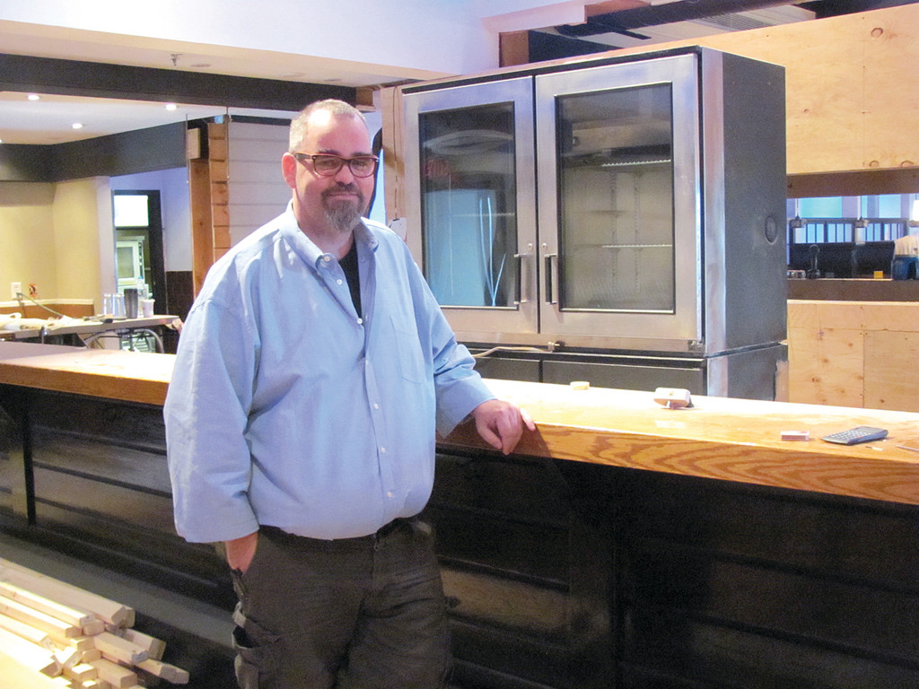 MAN BEHIND THE PLAN: Jack Doherty, who came to Rhode Island 26 years ago from his native home in Bronx, N.Y., stands by what will be one of two bars inside the 7,600-square foot building that will open at Doherty's Irish Pub. The building has housed four other restaurants over a 40-year span.