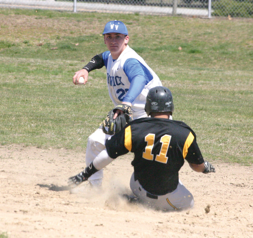 SPINNING IT: Vets shortstop T.J. Boyajian tries to turn a double play during Tuesday's game with Central.
