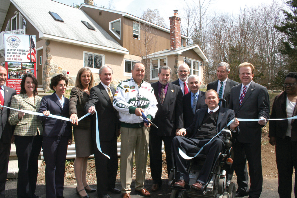 IT'S OFFICIAL: Elected officials and families of veterans cut the ribbon on the new property, located on the site of OSD's Johnston headquarters on Hartford Avenue.