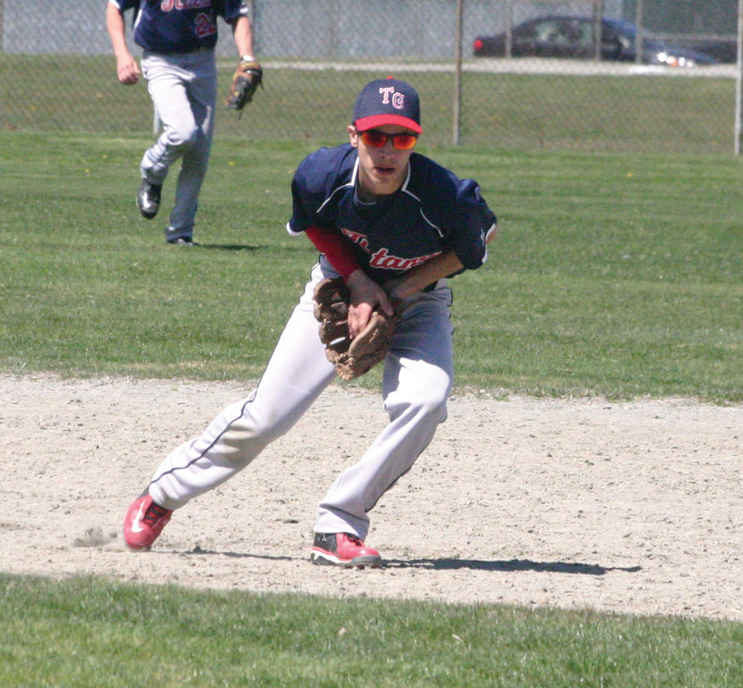 HOLDING IT IN: Toll Gate's Alex Lefebvre scoops up a ground ball at shortstop during Wednesday's game.