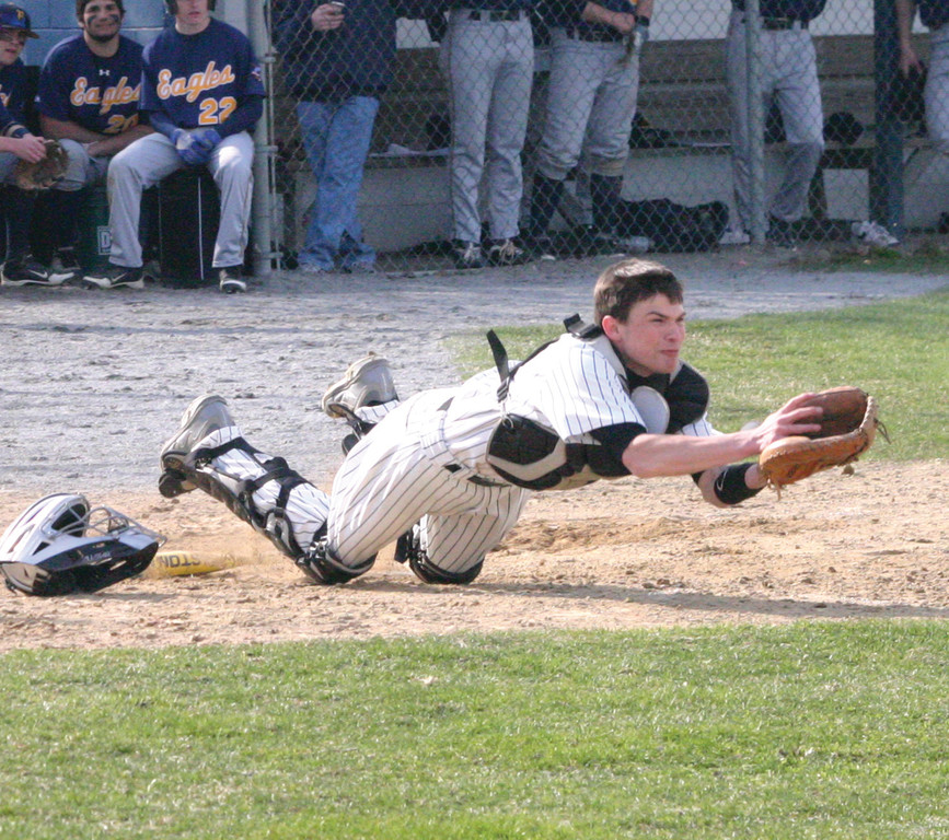 ALL ON THE FIELD: Tyler Galligan makes a diving attempt on a pop-up during Monday's game.