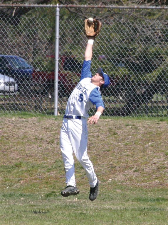 STRETCHING OUT: Tony Lonczak makes a leaping catch in center field.
