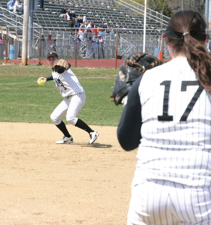 ACROSS THE DIAMOND: Pilgrim shortstop Katelyn Reph lines up a throw as teammate Caitlin Blanchard waits at first base during Thursday's game with Warwick Vets. Pilgrim cruised to a 12-0 win, its second victory this year over a city rival.