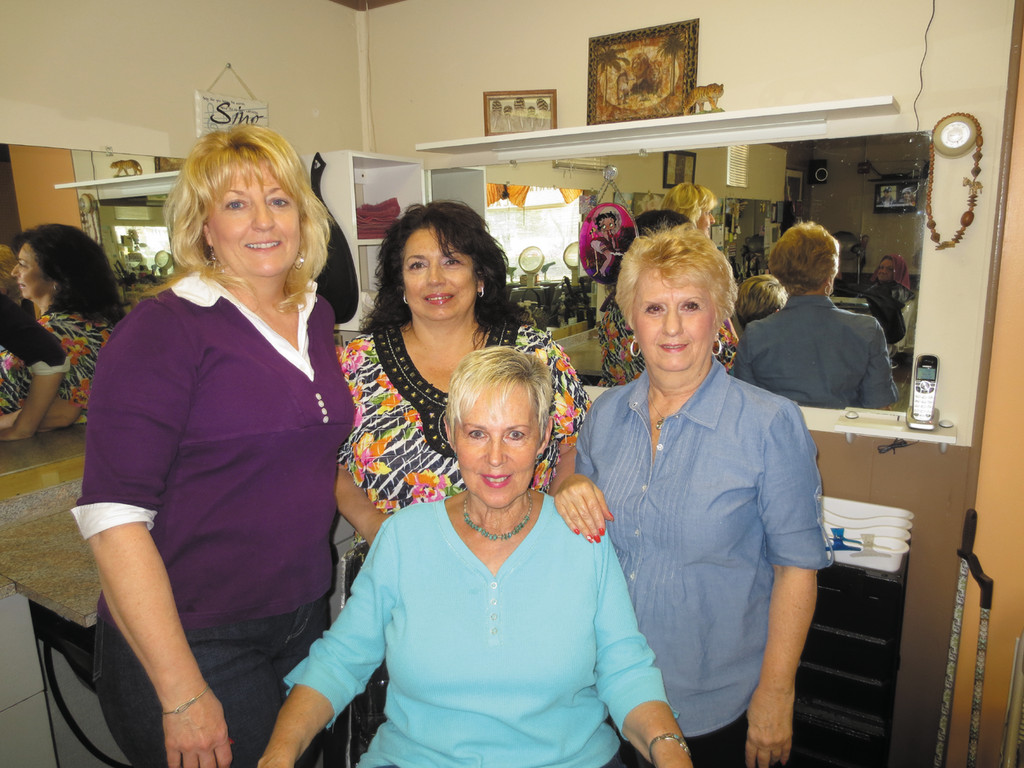 "Meet the close-knit team of Karen's Village Salon, Karen (center), Melynda, ""Dolly"" and Janice - and check out their $5.00 coupon."