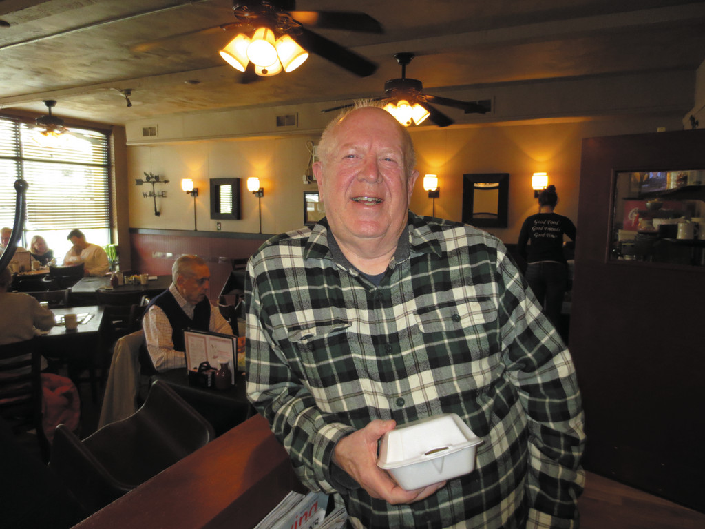 Longtime, loyal customer Arthur Chapman takes home a small portion of leftovers after his regular breakfast date at Buttonwoods Fish & Chips.