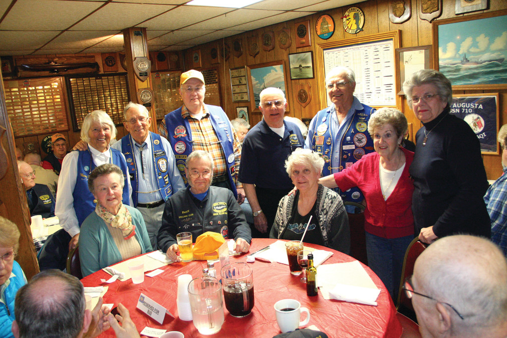 RHODE ISLANDERS: Rhode Islanders attending the club meeting held last Tuesday are (from left standing) Betty and Tony Faella, Paul Kelley, Jack Ward, Nick and Dot Calderiso and Betty Kelley. Seated are Ann and Bruce Dunham and Marion Ward.