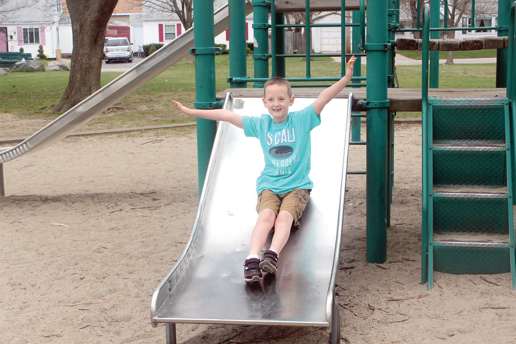 SLIDING INTO CONFIDENCE: Joshua Sangster, 7, a first grader at John Brown Francis, has autism, but he doesn't allow it to get him down. Instead, he aims to raise awareness for the cause.