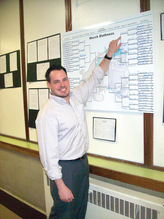 CHECKING THE STATS: Paul Nadeau, a sixth grade teacher at Garden City Elementary School, came up with an innovative way to connect probability, persuasive writing and basketball during last month's NCAA basketball tournaments. He credits Johnny's Signs for helping him to create an affordable, reusable sign so that he can teach the same unit again next year.