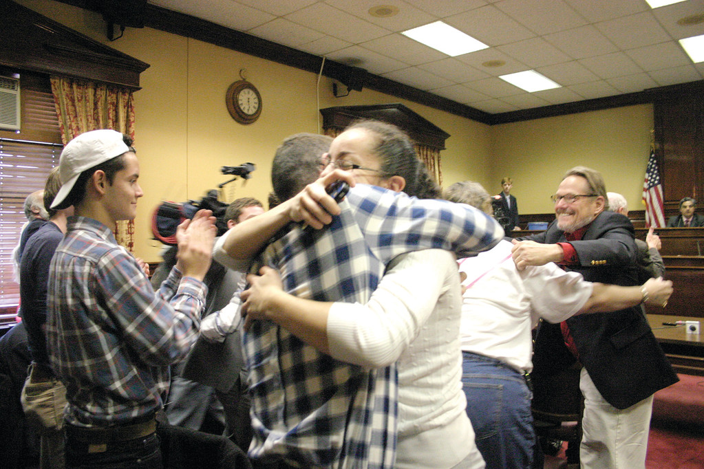 UNITED FOR MARRIAGE: Two members of the grassroots organization Rhode Island United For Marriage embrace after witnessing the Senate Judiciary Committee's 7-4 vote in favor of a bill that would legalize same-sex marriage.