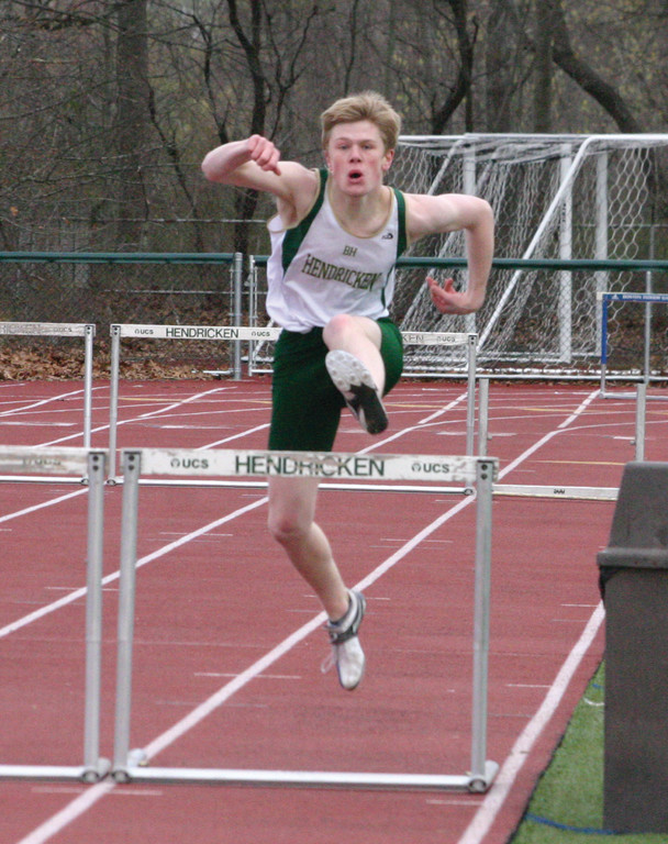 CLEARING IT: Hendricken's Brendan McNamara competes in a hurdles event during Monday's meet.