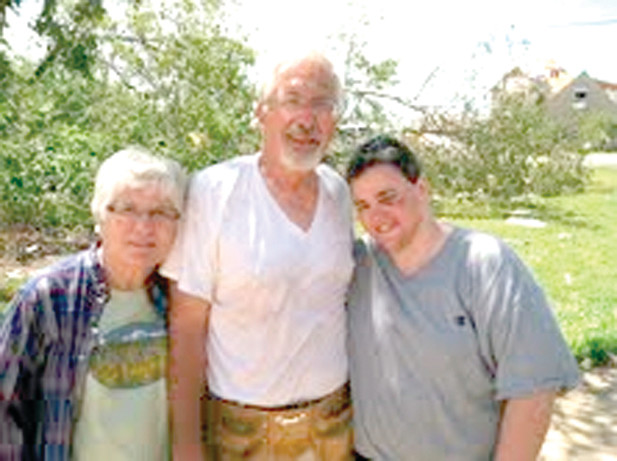 AFTERMATH: Jeri Schey located on the right is pictured here with Mary Bruckner and Jared Bruckner after a tornado hit McDonald, Tenn. two years ago this Saturday.