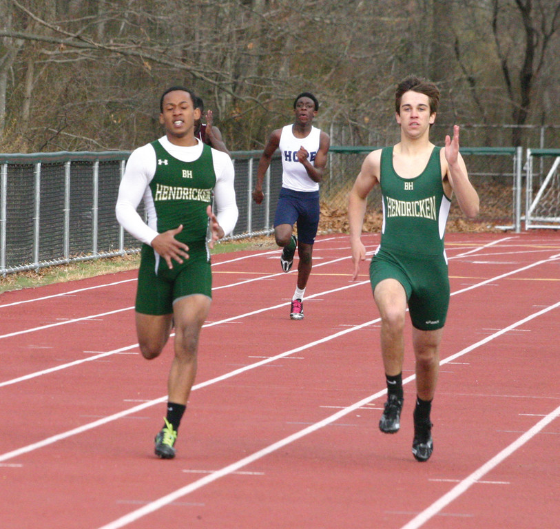 SIDE BY SIDE: Romario Rousseau and Ian McLeod sprint to the finish line on Monday.