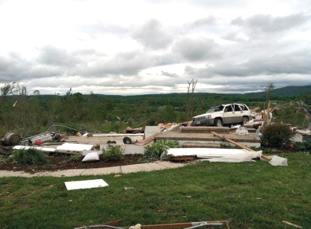 DESTRUCTION: Pictured here is one of the homes that was completely destroyed by the tornado. The truck is where the kitchen was and the basement is gone.