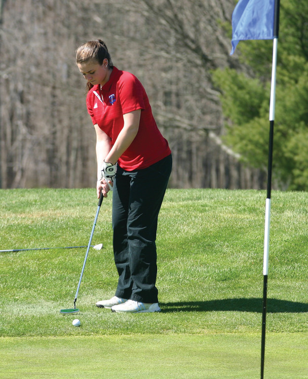 Toll Gate's Rachel Willett hits a putt from the fringe.