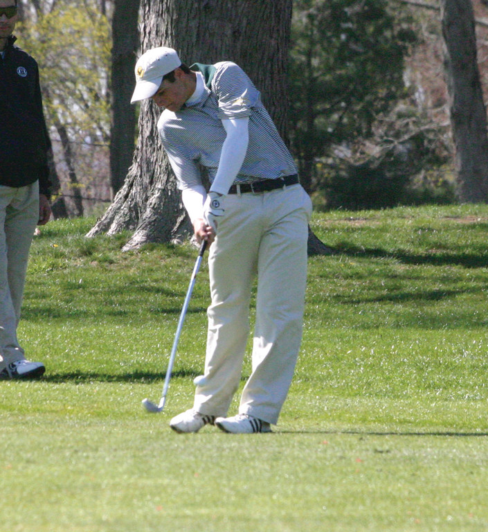 ON PAR: Hendricken's Justin Matrone takes a shot from the fairway during a match on Wednesday.