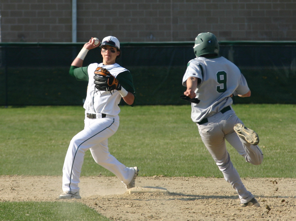 TURNING IT: Hendricken's Matt Murphy fires to first base to complete a double play in Friday's game against Cranston East. The Hawks won 1-0.