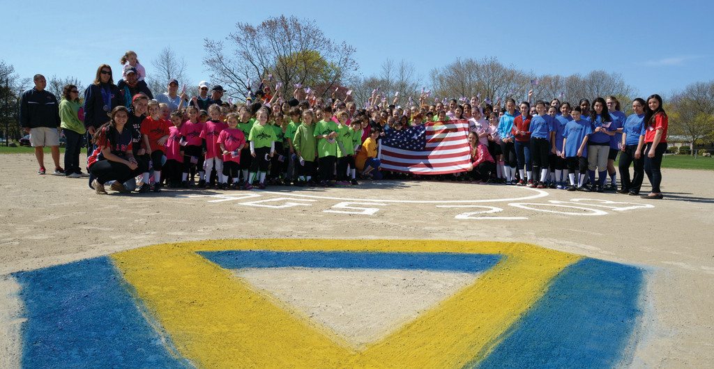 Members of Apponaug Girls Softball pose on the field during opening day.