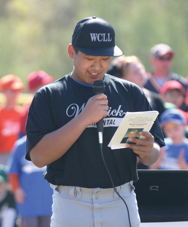 Stephen Pham reads the Little League pledge.