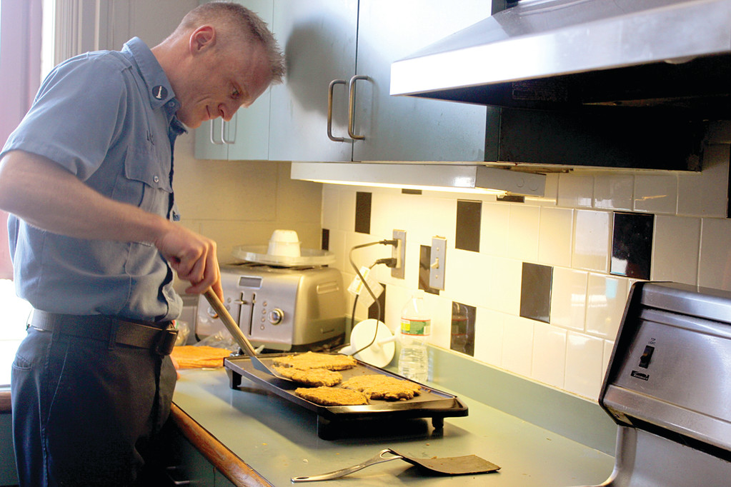 SEXY VEGAN: Things are heating up at the Warwick Fire Department, as Lt. John Halloran recently  became one of 10 male contestants to advance to the final round in PETA's Sexiest Vegan Next Door 2013 contest. Here, he cooks a vegan lunch for a group of his firefighter buddies.