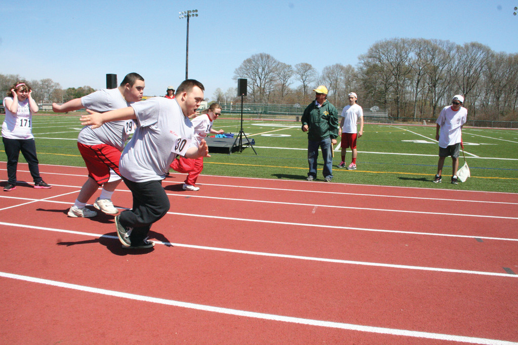 ON THE RUN: Contestants in the Special Olympics run the 100-meter dash.