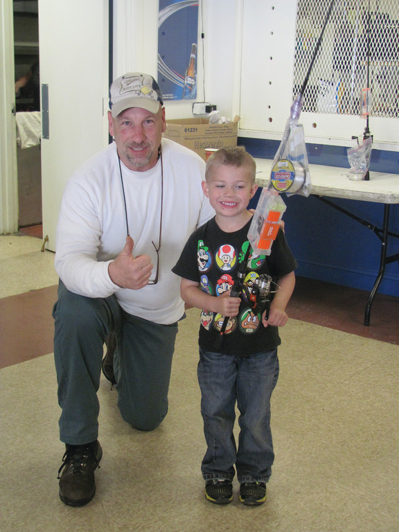 PERFECT PRIZE: Brady Safford, 5, is all smiles as he accepts a fishing pole and reel from Griff Williams after winning the Under 6 Division of Saturday�s firth annual Fishing Derby at the Tri-City Elks Lodge 14 in Warwick. His prize-winning catch weighed in at 57 ounces.