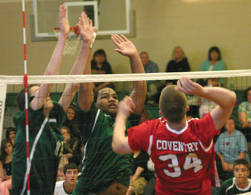 TWO AT A TIME: Donny Baker (left) and Mario McClain set up to block a kill attempt by Coventry's Tom Campbell.