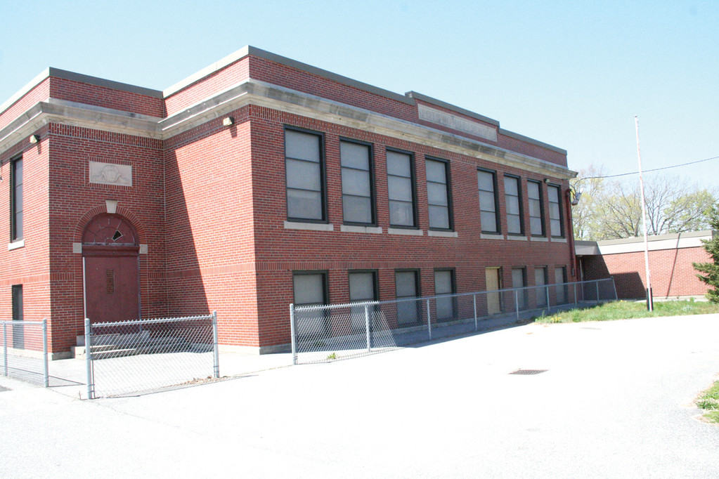DEMOLITION RECOMMENDED: The former Potowomut School would be demolished to make room for a fire station if the City Council approves bonding for the project.