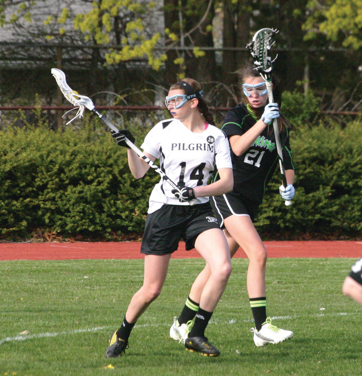 HOLDING IT: Pilgrim's Michaela Giuttari watches the ball into her stick during Monday's victory over Smithfield. Pilgrim fell behind 1-0 but rolled from there, winning 18-5 to improve to 6-1.