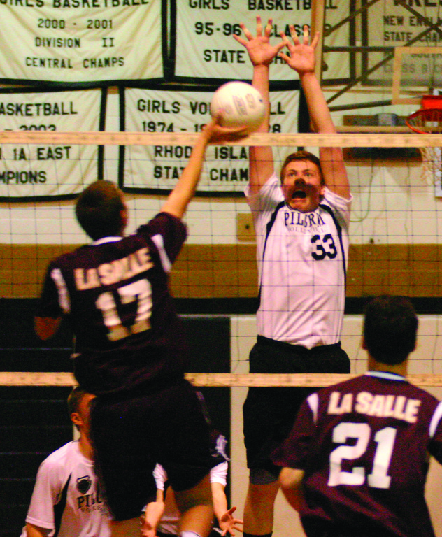 SOLID NIGHT: Above, Dan Colabella goes up for a block in Tuesday�s game. He had 10 blocks on the night. Below, Josh Salinger lets go of a serve.
