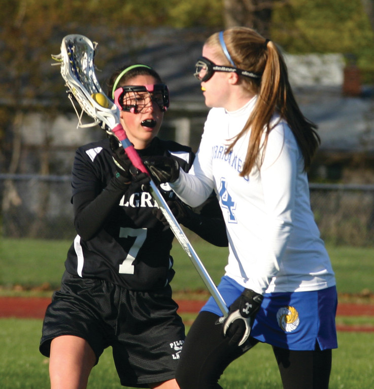Casey Bennett looks for an opening as Pilgrim's Julianna Mollo stays close during first-half action.