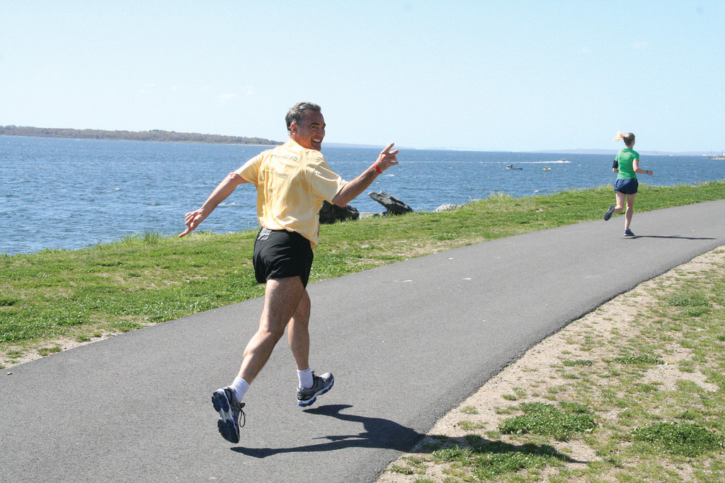 SMILE ON THE RUN: J.R. Pagliarini of Warwick shows off some enthusiasm as he runs the Rocky Point 5K.