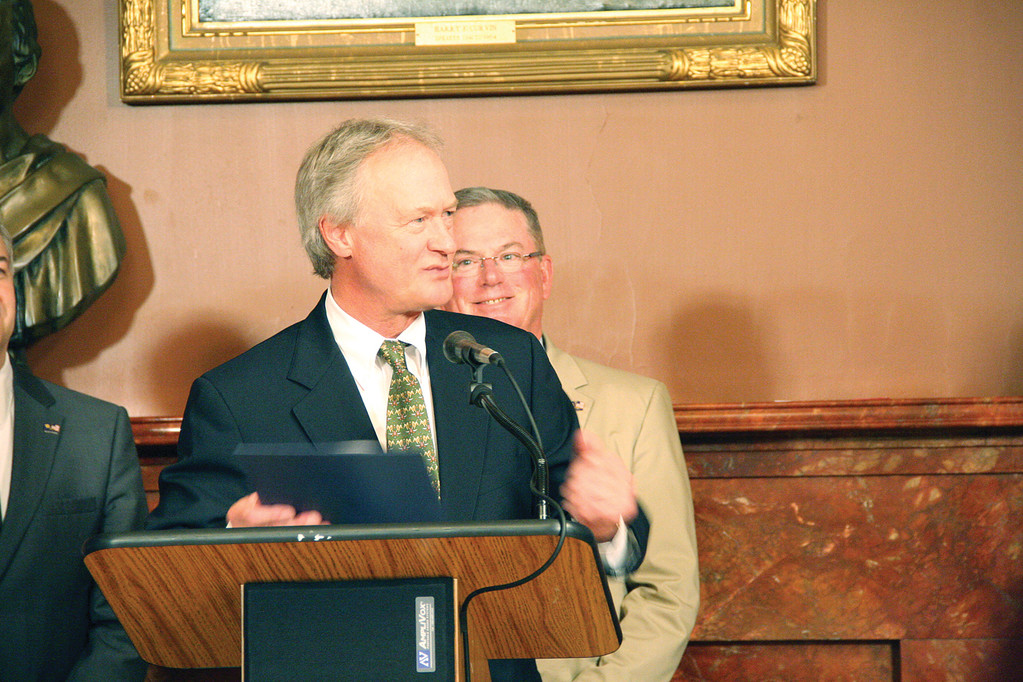GETTING OUT THE WORD: Gov. Lincoln Chafee, with master of ceremonies Rep. Joseph McNamara looking on, spoke of the benefits of the Gaspee Days celebration at Thursday's event.