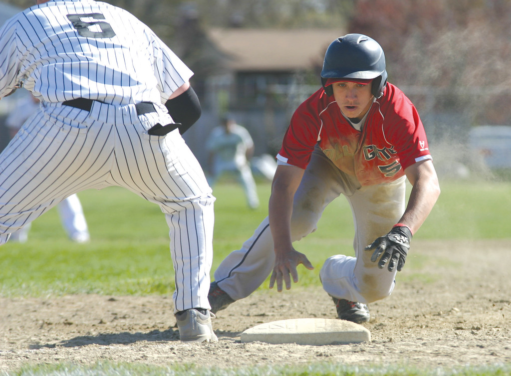 GET BACK: Toll Gate's Evan Stamps dives back to first  during last week's game against Pilgrim.
