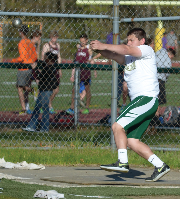 SWINGING: Hendricken's Cory Woodbine throws the hammer at Monday's Central Division Championship.
