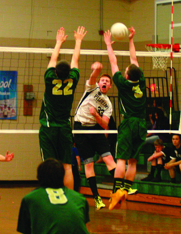 BIG SWING: Dan Colabella smashes a kill during Pilgrim's match with Hendricken.