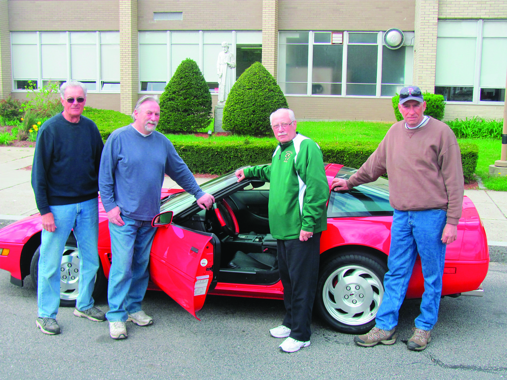 HAWK HONCHOS: These are just four of the many people who will be working at Sunday's fourth annual Bishop Hendricken High School Car Show on the Hawks' campus in Warwick. The event benefits the school's Inner City Scholarship Fund. Volunteer organizers are, from left: Bill Campbell, Ron Mosca, Chairman Mike Benedetto and Jeff Nicholson. The event will run from 2 to 4 p.m. and vehicle registration is only $5 per car or truck.