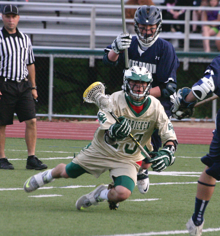 GOING DOWN: Hendricken's Jonathan Finelli holds onto the ball as he falls to the ground during Friday's game.