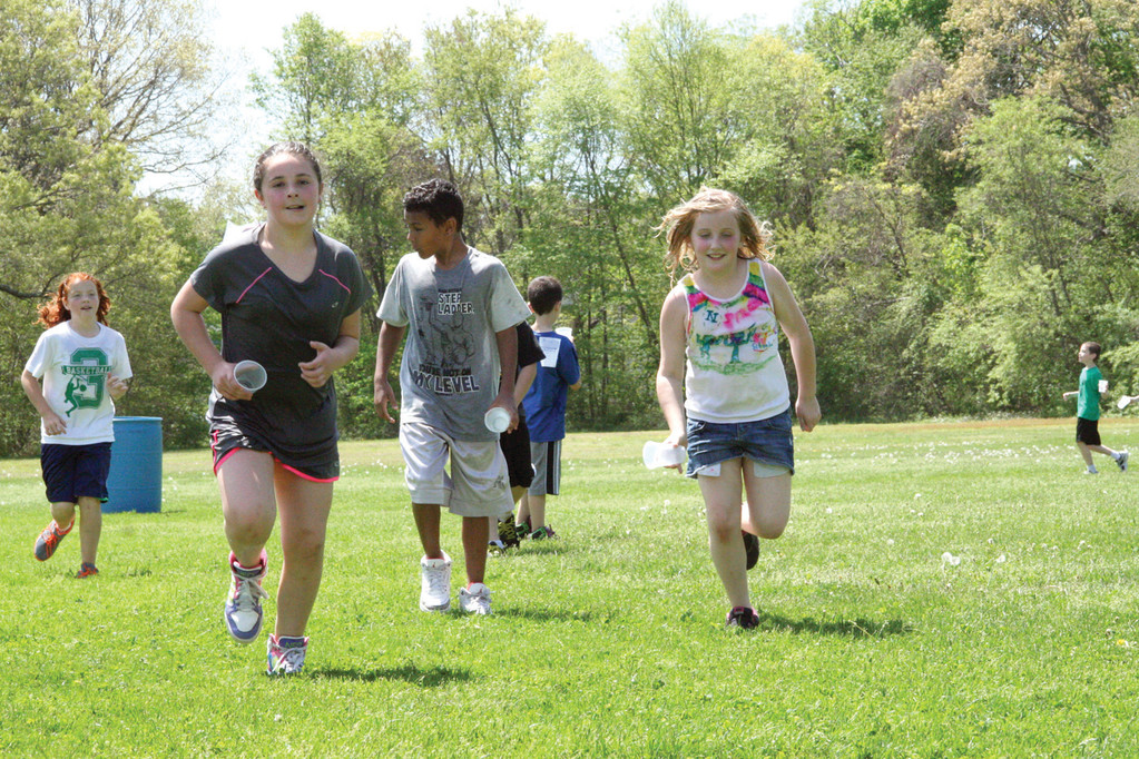 SPRINT TO THE CHECKOUT: With a sudden burst of energy, students run to the next checkpoint in the school walk-a-thon Friday.
