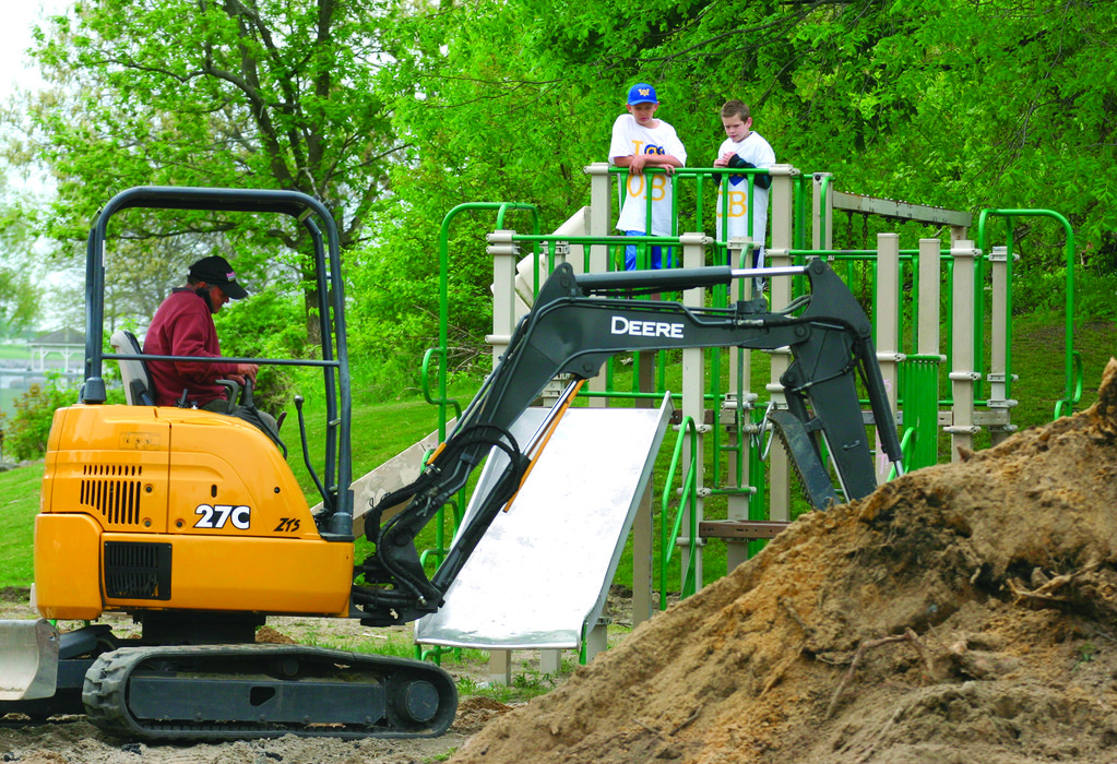 SUPERVISING: Kids watch from the playground as construction begins on George E. Schmeider Memorial Park.