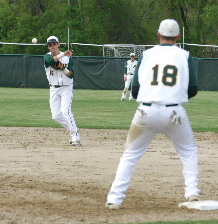 Matt Murphy throws to Billy Keegan at first base.