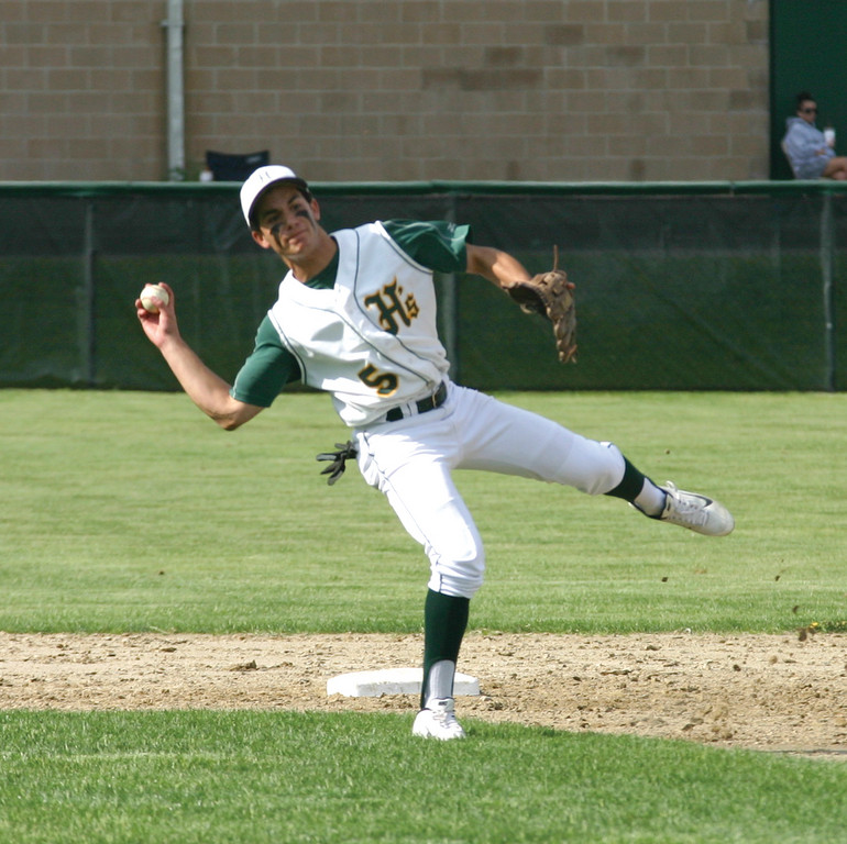 BALANCING ACT: Hendricken shortstop Lou Umberto makes an acrobatic throw after bare-handing a ground ball.