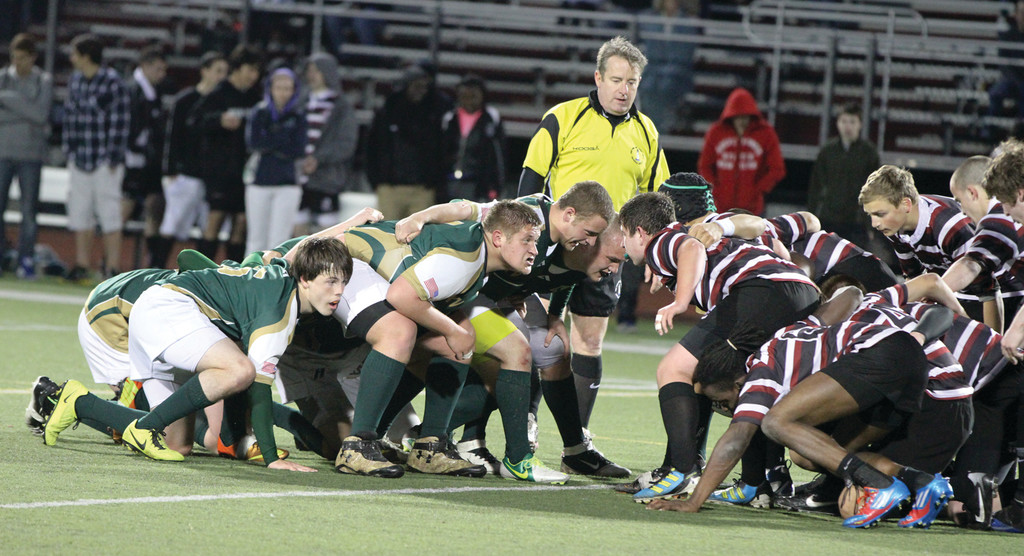 Hendricken players line up across from an opponent.