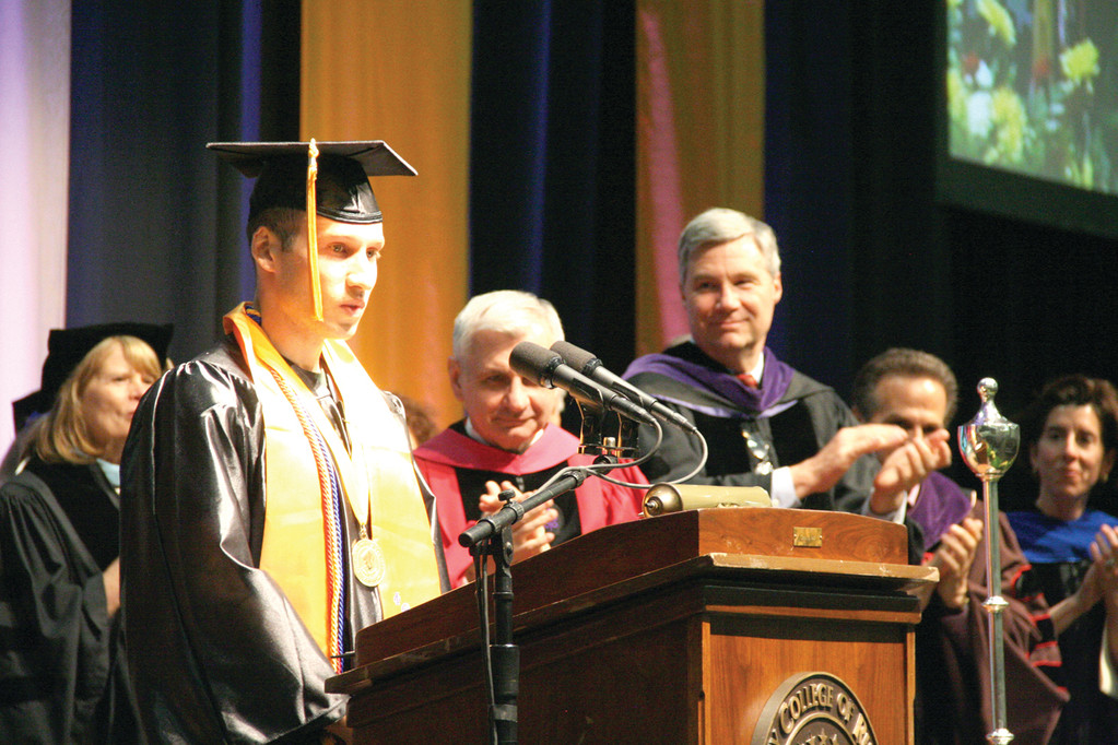 STUDENT SPEAKER: Graduate Albino Folcarelli, who addressed his classmates, is congratulated following his remarks.