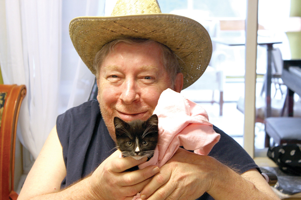 COWBOY AND A CAT: Joe Lannon plays the part of a cowboy accompanied by a cute kitten.