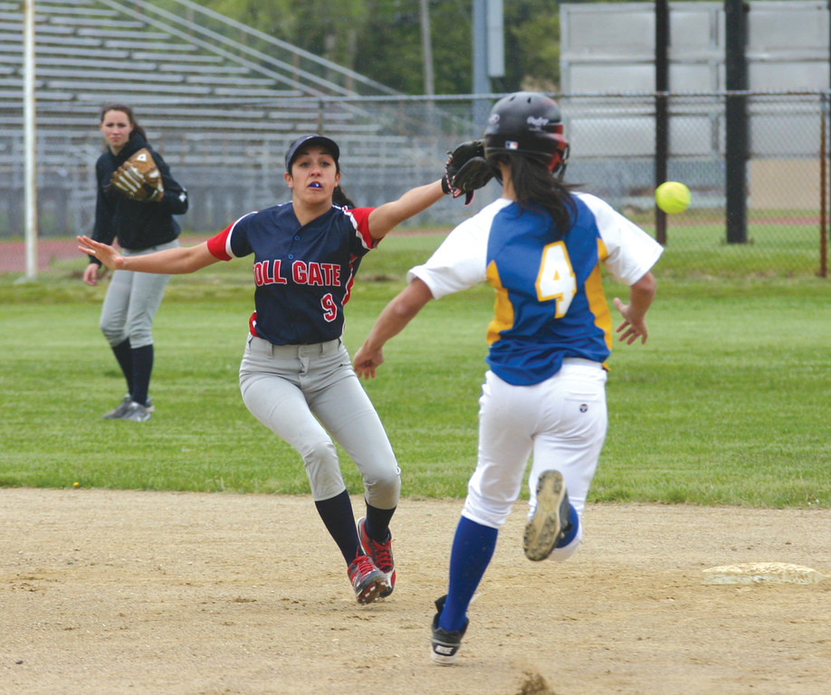 COLLISION COURSE: Vets� Mariana Brawn heads for the bag as Toll Gate shortstop Jenna Beauchamp gets out of the way after a throw from the plate sailed wide.